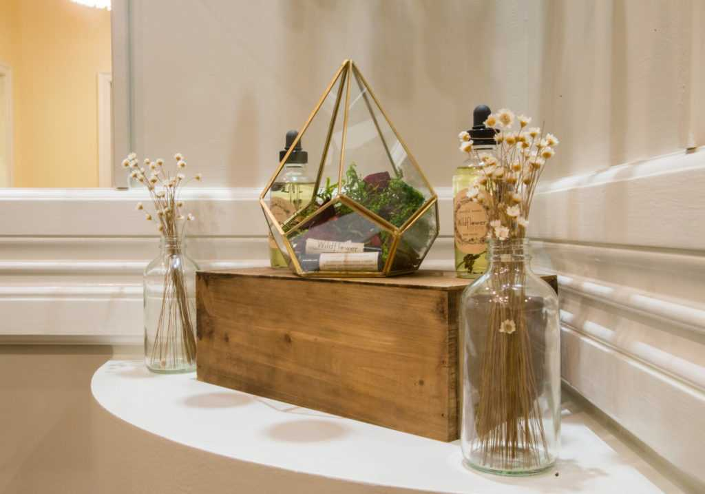 a prepared arrangement of relaxing decor of flowers, moss and creams
